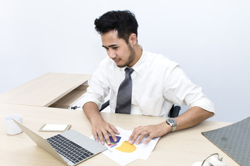 Young businessman  is 20-30 years old strain and worry at office.Man hands typing on computer keyboard .Copy space.