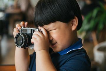 boy taking photo like professional