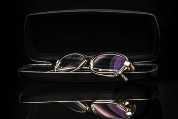 Glasses in a case on a black background