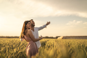 Romantic Couple on a Love Moment at gold wheat field