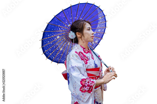 Wall mural Asian woman wearing japanese traditional kimono with umbrella on white background.