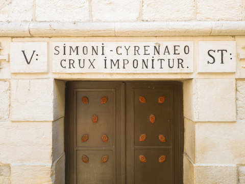 """Sign indicating the point where """"Simon of Cyrene gave the cross"""" to Jesus Christ, Jerusalem old town, Israel"""