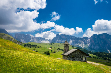 A small church in Gruppo delle Odle. Puez Odle massif in Dolomites mountains, Italy, South Tyrol Alps, Alto Adige, Val Gardena, Geislergruppe