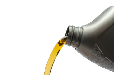 Pouring oil from bottle on isolated white background