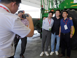 Chinese trade delegation poses for a picture on a farm near Norborne, Missouri