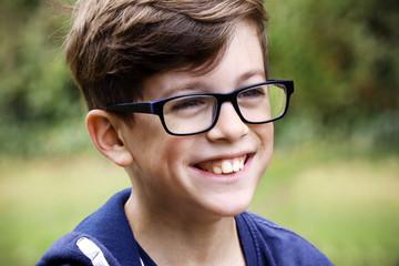 Boy in glasses smiling