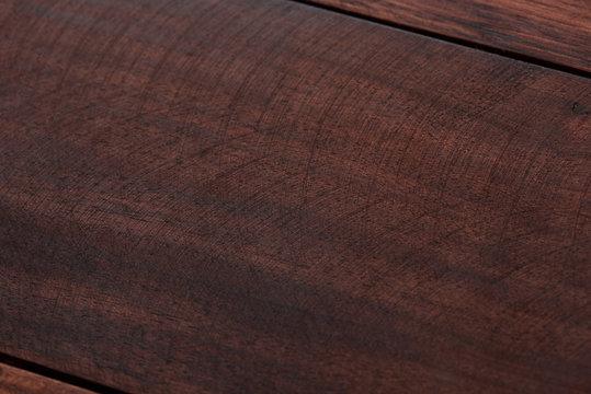 Polish line on dark wooden surface