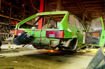 floor car dismantled on a lift; Image of a car repair garage