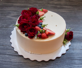 Biscuit cake with berries and flowers
