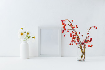 Mockup white frame and branches with small red apples
