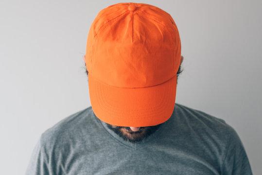 Man wearing orange baseball cap for mockup