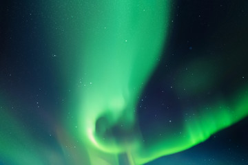 Vector illustration with beautiful starry sky and Northern lights. Abstract colorful background with green aurora borealis.