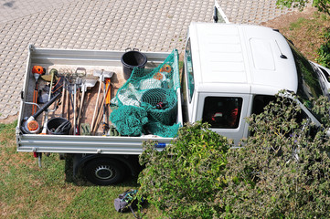 gardening tools on back of a pickup
