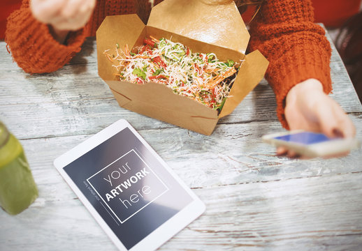 Woman Using Smartphone and Tablet While Eating Takeout Mockup