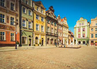 Wall Mural - facades of medieval houses on the central market square in Poznan, Poland, retro toned