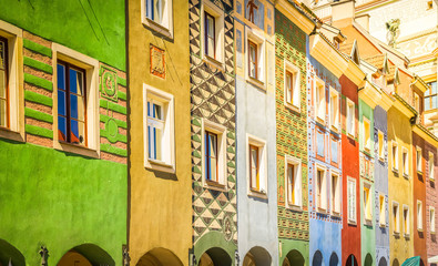 Wall Mural - facades of colorful crooked medieval houses on the central market square in Poznan, Poland, retro toned