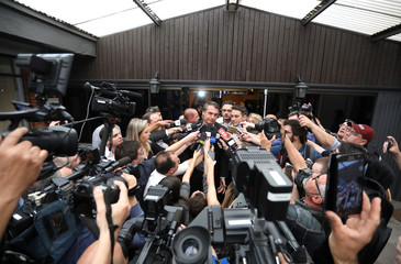 Presidential candidate Jair Bolsonaro talks with journalists during an agribusiness fair in Esteio