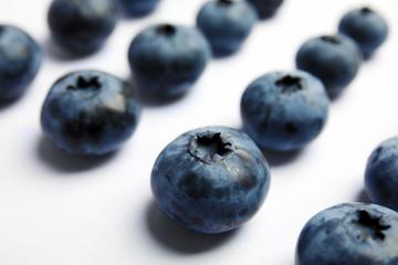 Tasty blueberry on white background, closeup