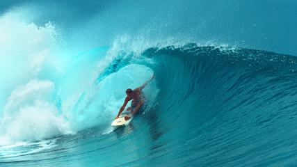 CLOSE UP: Professional surfboarder finishes riding another epic tube wave.