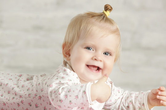 Portrait of a cute baby girl smiling cheerfully