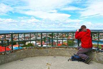 Unrecognizable Tourist taking photo of Scenic view of Punta Arenas, Chile. Magellan Strait. Patagonia,  South America