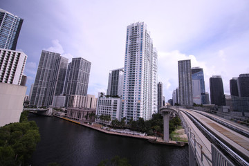 Cityscape of Miami Skyline with Tall Buildings and Train Bridge Over the River in Brickell