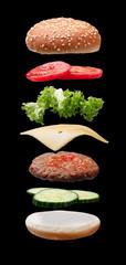 Hamburger Ingredients On Black Background