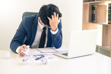 Depressed failure and tired businessman late sad and solving problem in office. in meeting room. stressed and worried at work crisis concept