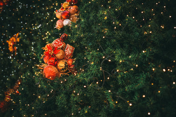 Wall Mural - Christmas tree with ball decoration with light on tree. Christmas and New Year holiday background. vintage color tone. close-up shot.