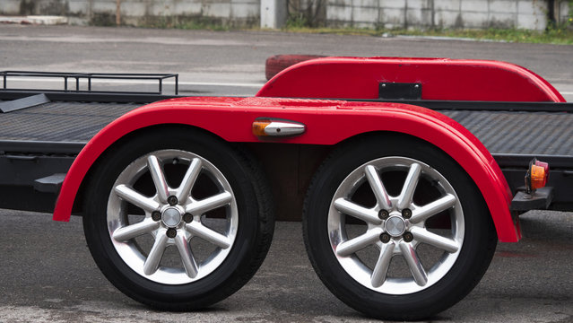 Red car trailer with two wheel axle