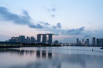 Singapore skyline in sunset scene with pink and blue sky taken from Marina barrage. Citiscape workshop concept
