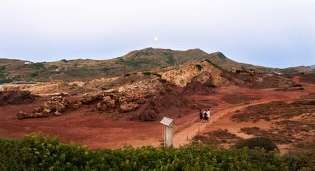 Cala Tirant Minorca Baleari Islands Spain. Beautiful red soil landscape at sunset, resembling a Martian landscape.