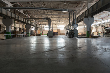 Warehouse of lumber at the woodworking plant. Shop woodworking plant