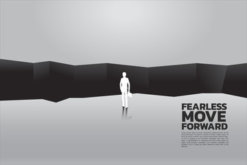 silhouette of businessman with briefcase step forward to abyss. concept of business challenge and courage man Wall mural