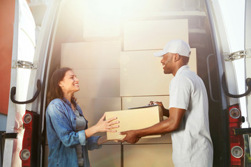 Delivery Service. Courier Delivering Package To Woman Near Car