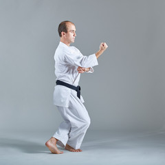 Young athlete trains formal karate exercises