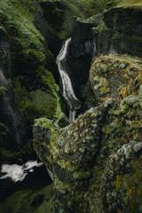 Fjadrargljufur canyon in Iceland green grass small waterfall