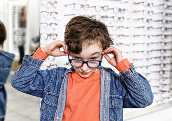 boy  in glasses at optics store