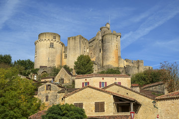 View of  historic Chateau de Bonaguil near Fumel on a sunny autumn afternoon in Lot et Garonne, France