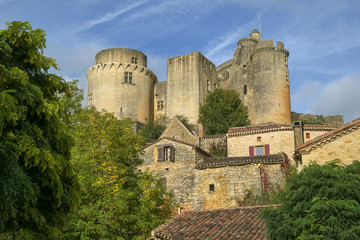 Looking up at historic and  imposing Chateau de Bonaguil near Fumel on a quiet sunny autumn afternoon in Lot et Garonne, France