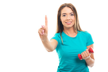 Young pretty girl wearing t-shirt showing number one with finger.