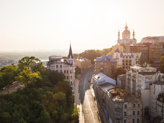 Andrew's Descent. Castle of Richard the Lionheart and St.Andrew's Church. Soft sunrise light. Morning in Kiev (Kiyv) Ukraine. Podil. Aerial drone photo