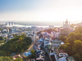 Foto auf Leinwand Kiew Lovely Kiev Ukraine. Andrew's Descent old street. Panaramic aerial drone sunrise view. Historical center