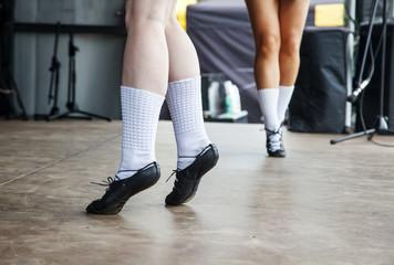 female legs of three irish dancers