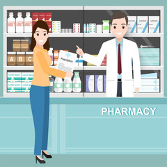 Pharmacy or drugstore with  pharmacist and woman holding prescriptions