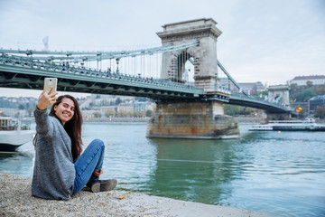 portrait young pretty woman old chain bridge on background
