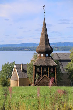 Wooden bell cage in Sweden, built in 1752,  with Hackas church and lake Storsjon in background