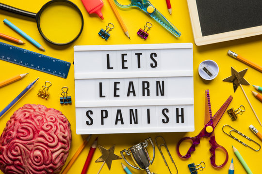 Lets learn spanish lightbox message on a bright yellow background