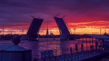 Fotobehang - Sunrise on Neva River with Palace Bridge raised and Peter and Paul Fortress in background. Saint Petersburg, Russia. 4K UHD Timelapse.