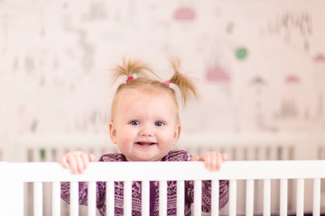 cute portrait of a 8 month old girl with pig tails